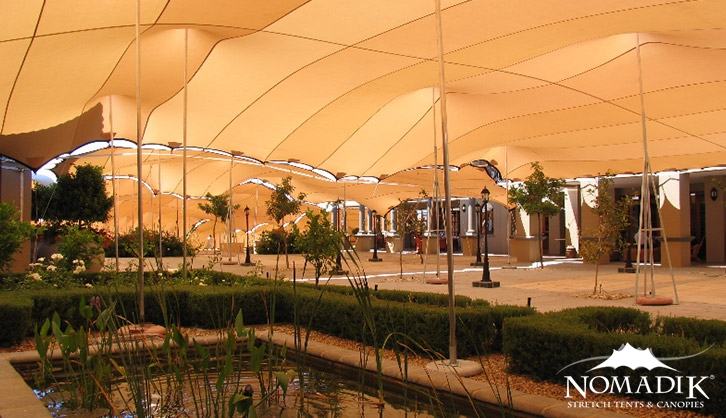 Stretch tent with water feature
