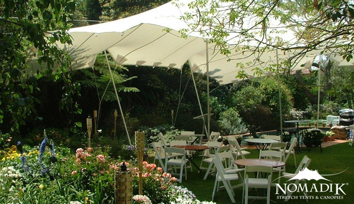 Stretch tent in rustic garden venue