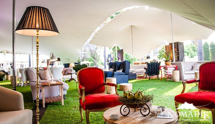 A lounge created inside a stretch tent