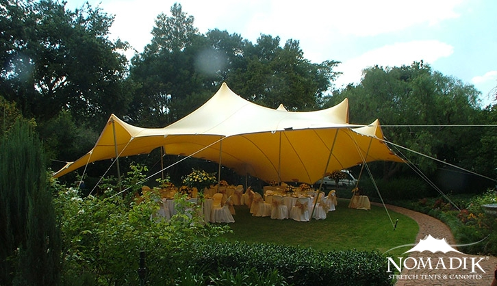 Yellow stretch tent in garden