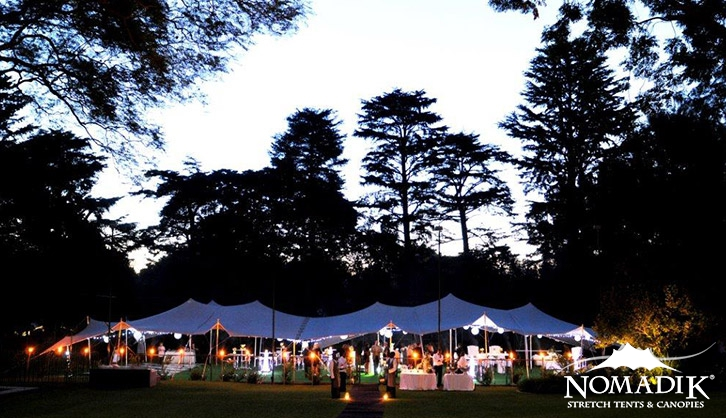 Stretch tent at night-time garden venue