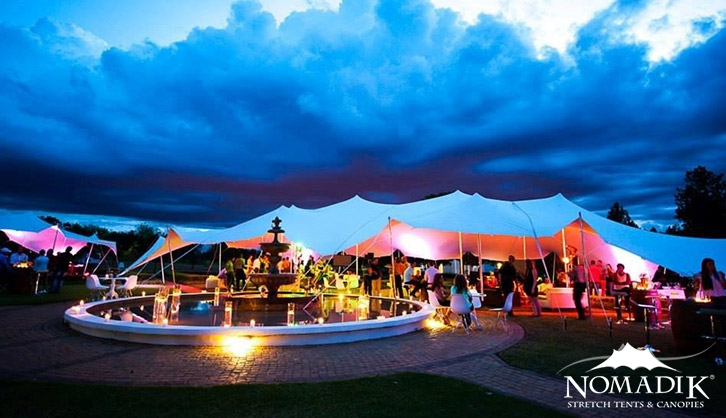 Lighting accentuates the stretch tent contours