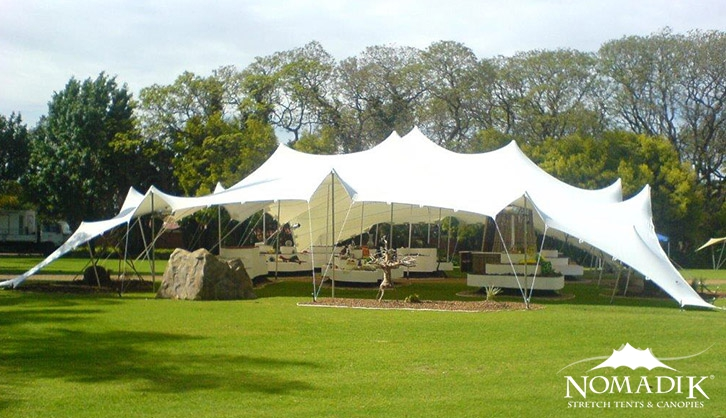 Stretch tent with landscaping features