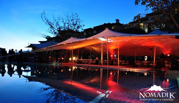 Pool-side stretch tent at dusk