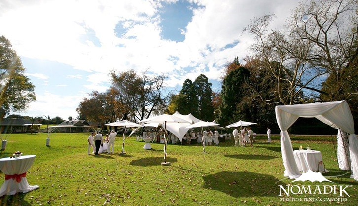 White themed stretch tents for corporate party