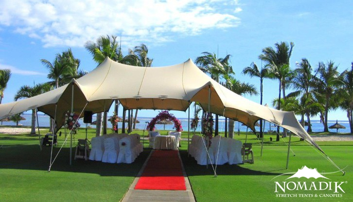Wedding ceremony at Sugar Beach takes place under our stretch tent