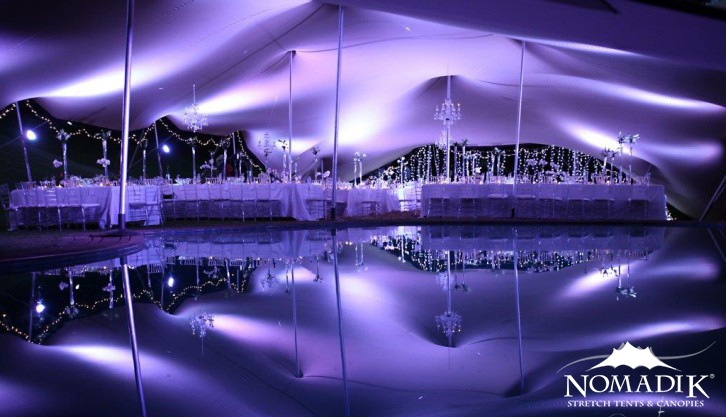 Beautifully lit stretch tent event at night