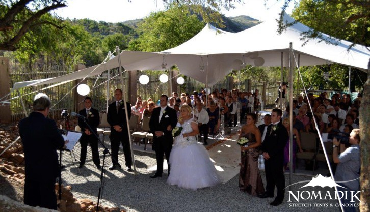 Stretch tents protect guests from the sun during the wedding ceremony