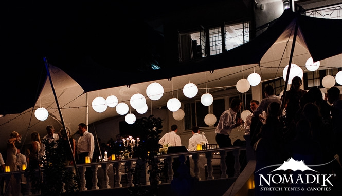 Stretch tents create a gorgeous night-time party atmosphere