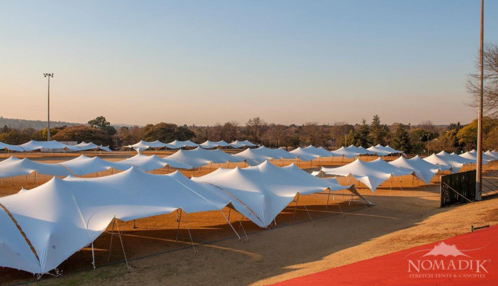 White stretch tents at Walk the Talk - the largest commercial stretch tent event in world