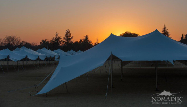 Sunset behind stretch tents at Walk the Talk