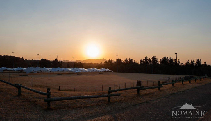 Sunset over stretch tents at Walk the Talk