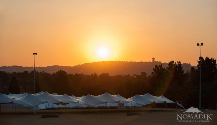 Sun sets over stretch tents at Walk the Talk